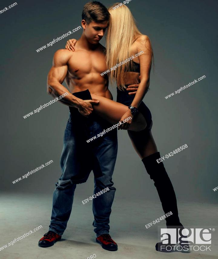 Muscl guy around sexy girls holding them Handsome Muscular Shirtless Guy Holding Long Leg Of His Sexy Blond Young Woman Stock Photo Picture And Low Budget Royalty Free Image Pic Esy 042488508 Agefotostock