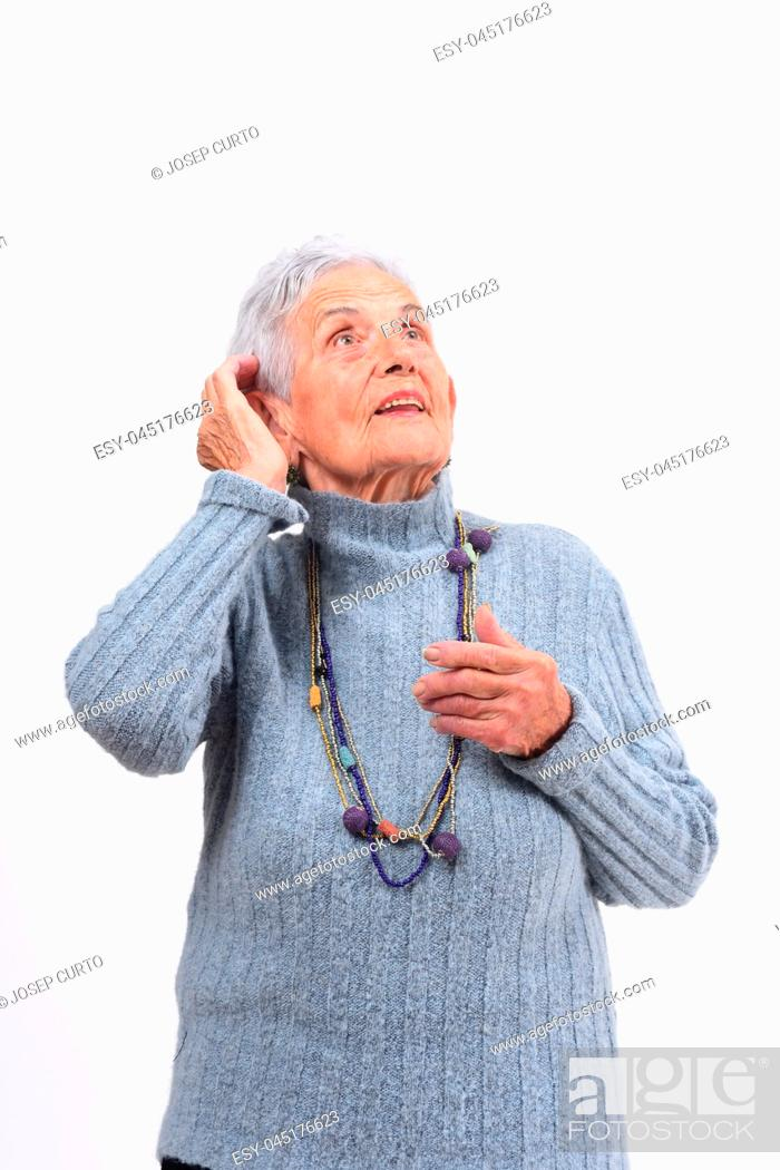 Photo de stock: senior woman having a doubt or question on white background.