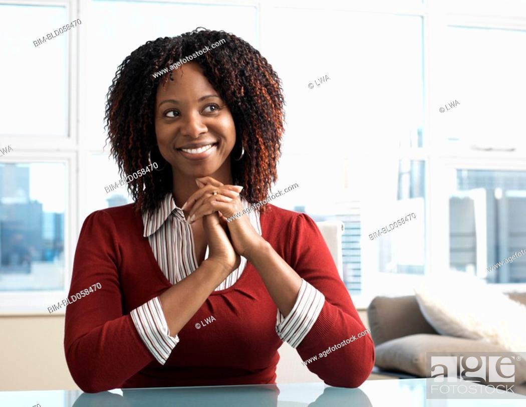 Stock Photo: African businesswoman looking sideways.