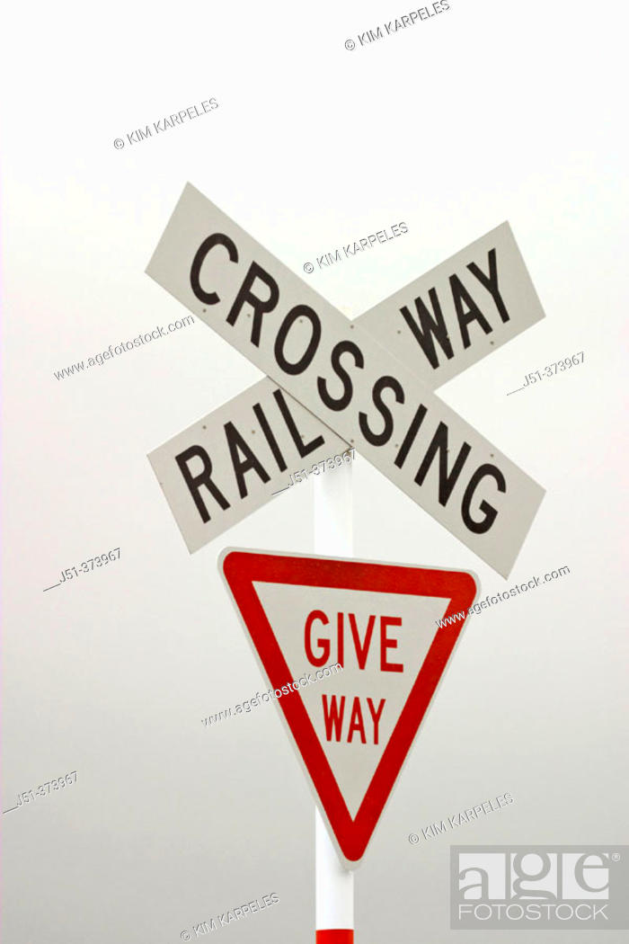 Stock Photo: Railroad crossing sign, give way sign, foggy day. Fairlight. New Zealand.