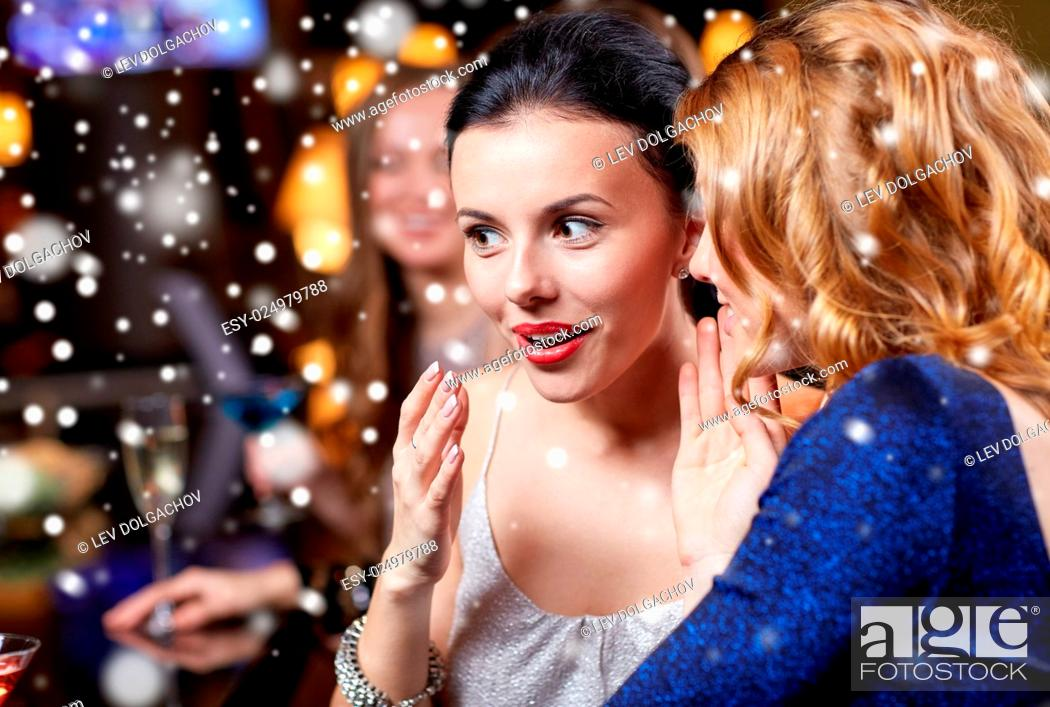 Stock Photo: new year, christmas, winter holidays and people concept - happy women gossiping at night club over snow.