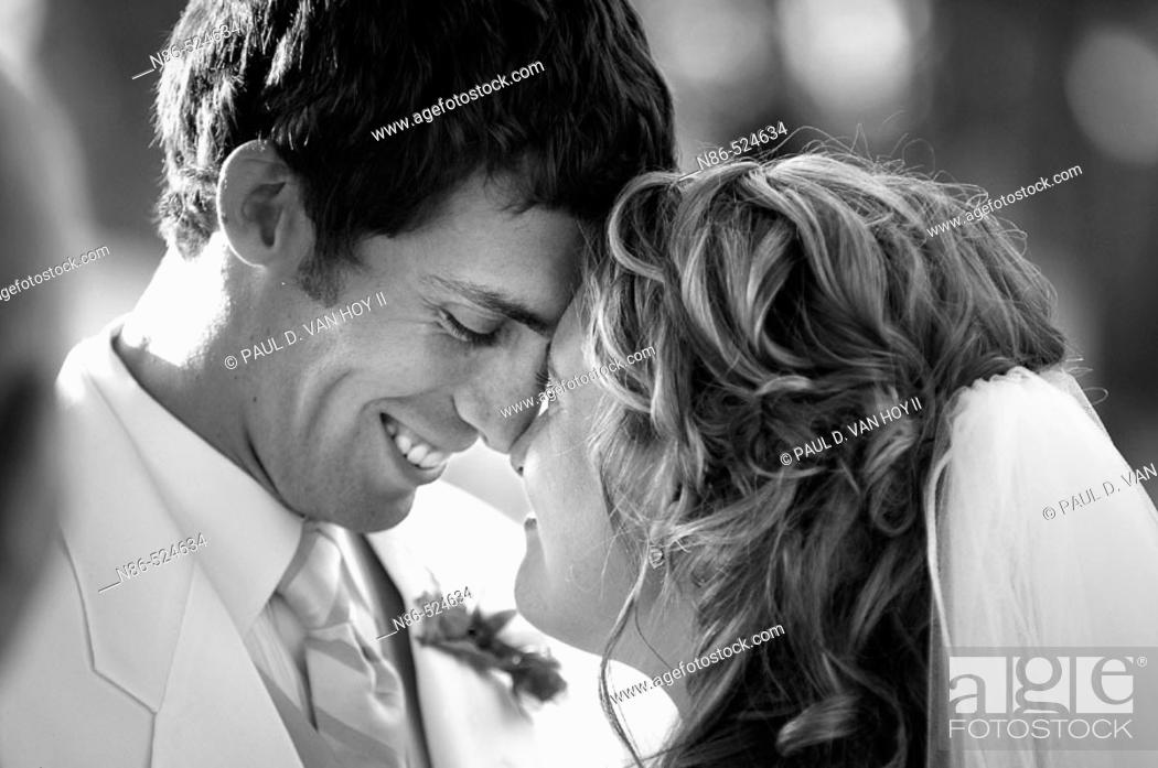 Stock Photo: Bride and groom with heads touching.