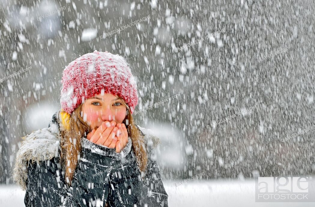 Stock Photo: freezing young woman warming his hands.