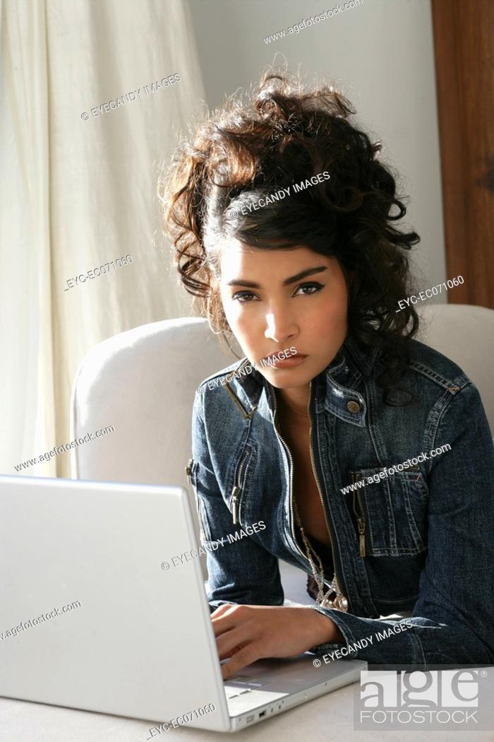 Stock Photo: Young stylish woman using laptop.