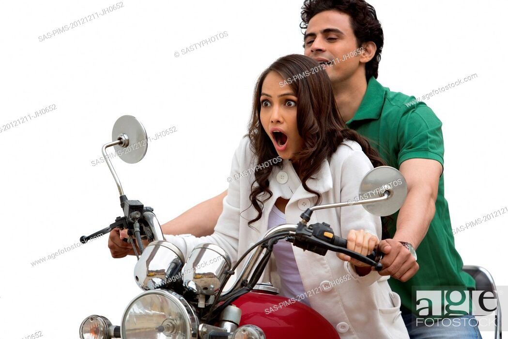 Stock Photo: Couple riding a motorcycle.
