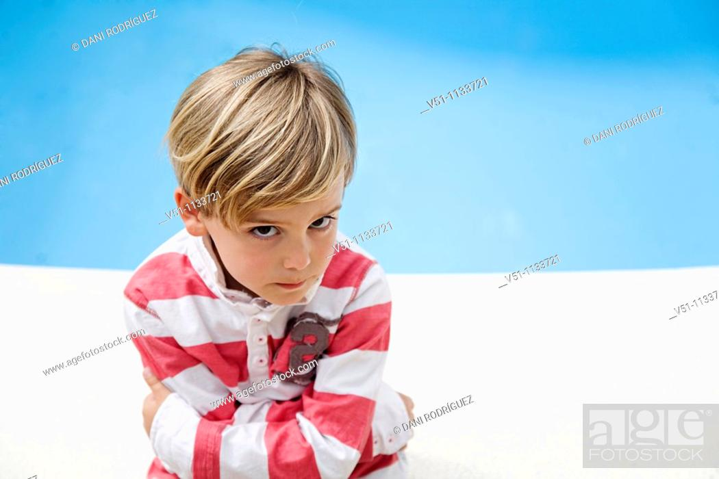Stock Photo: Young kid angry beside a Pool.