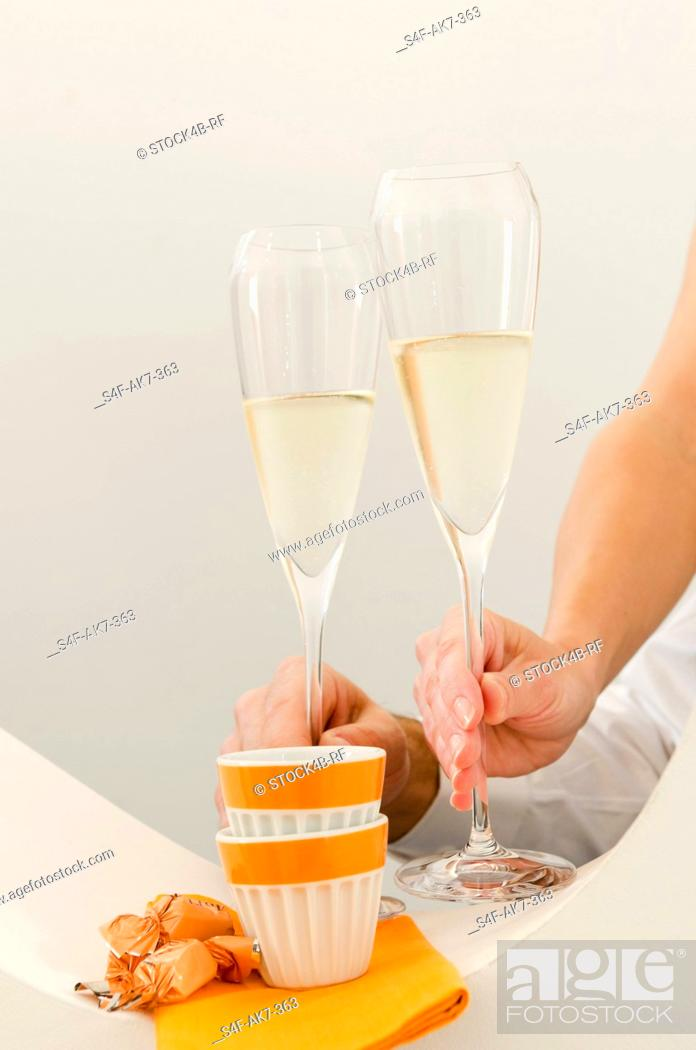 Stock Photo: Couple clinking champagne glasses.