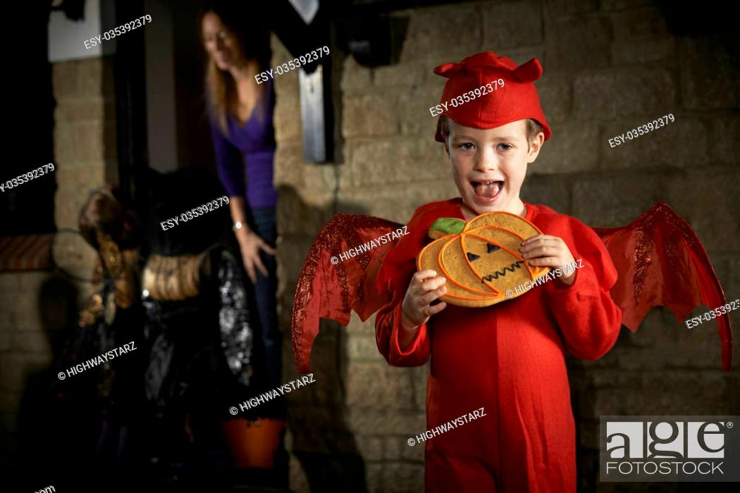 Stock Photo: Halloween Party With Children Trick Or Treating In Costume.