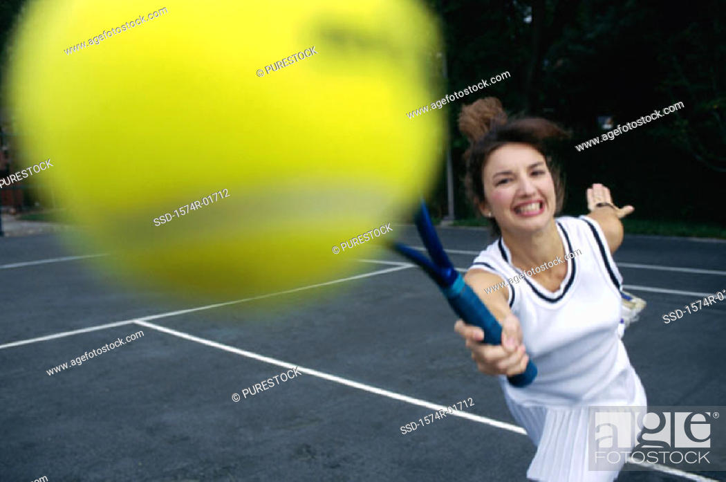 Stock Photo: Close-up of a young woman playing tennis.
