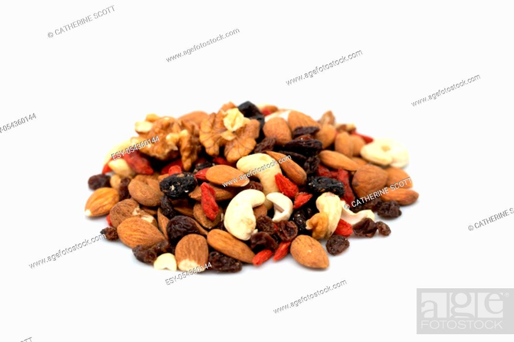 Stock Photo: Pile of mixed fruit and nuts on a white background.