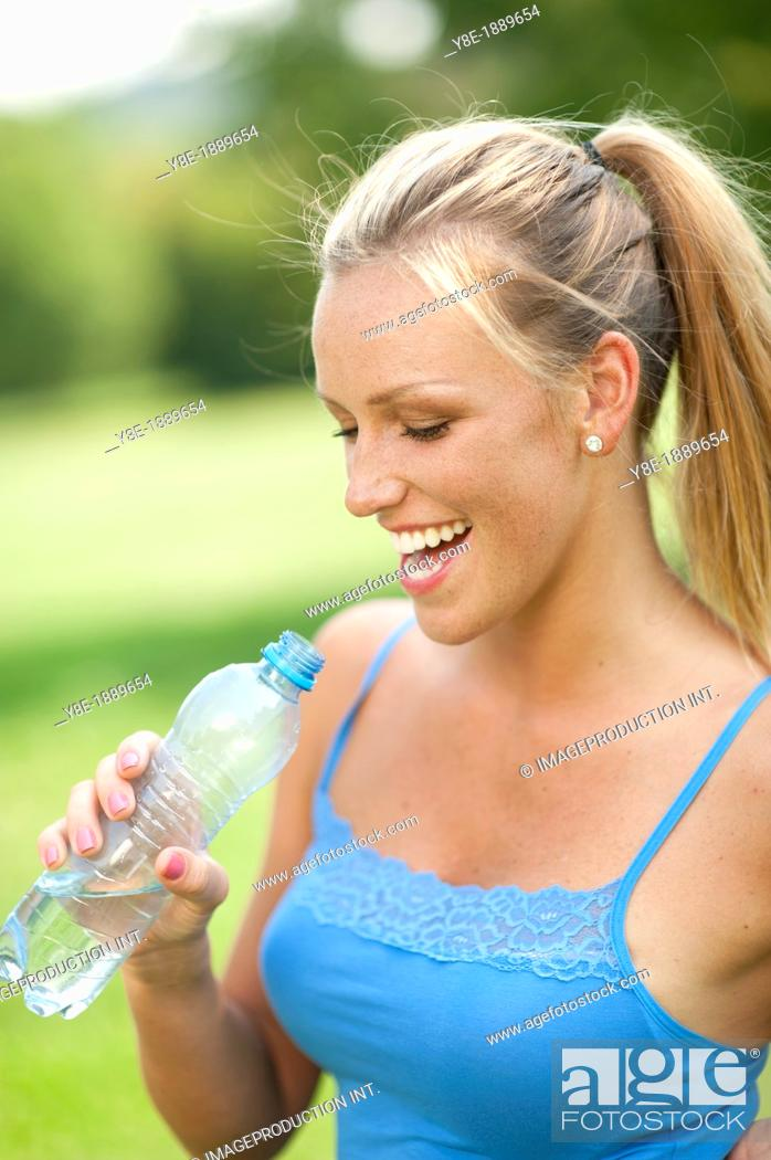 Stock Photo: Woman drinking water.
