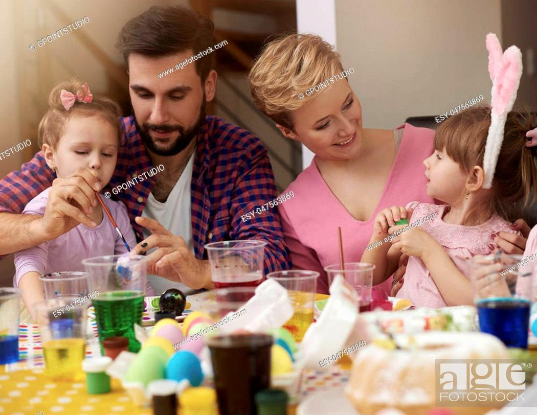 Stock Photo: Mother and father spending time with their little girls.