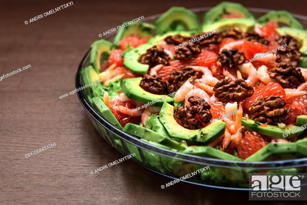 Stock Photo: avocado salad with grapefruit, butter, walnuts and balsamic vinegar.