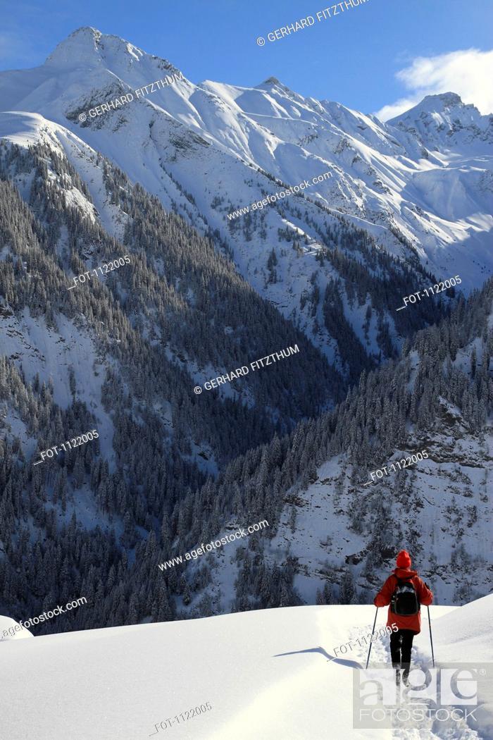 Stock Photo: Person hiking on snowy mountain.