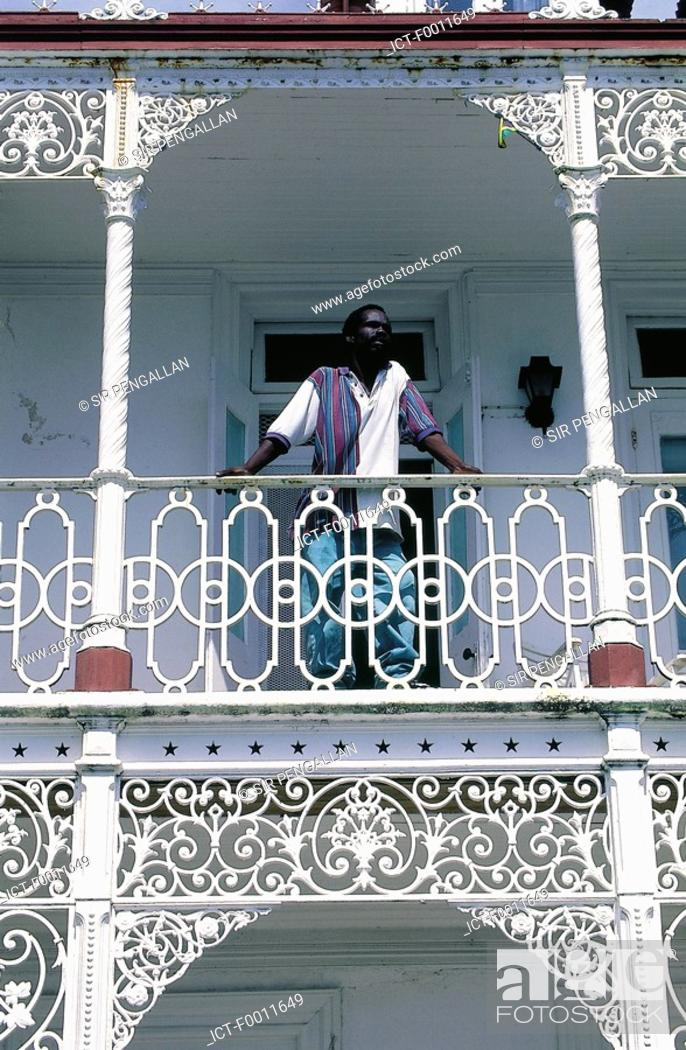 Stock Photo: Jamaica, Port Antonio, old colonial house, detail of a cast-up grid.