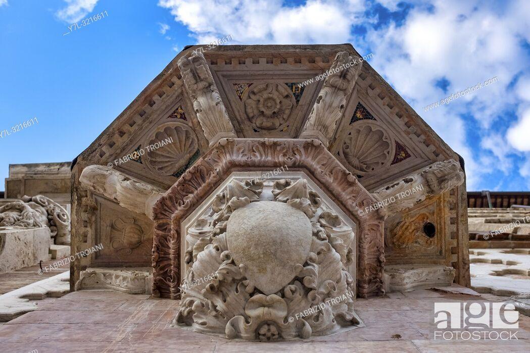 Stock Photo: Lower details of the Saint Bernardino da Siena pulpit on the Duomo di Perugia, Italy.
