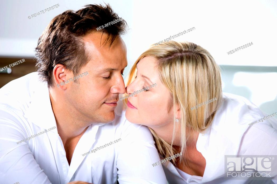 Stock Photo: Germany, Mid adult couple touching nose.