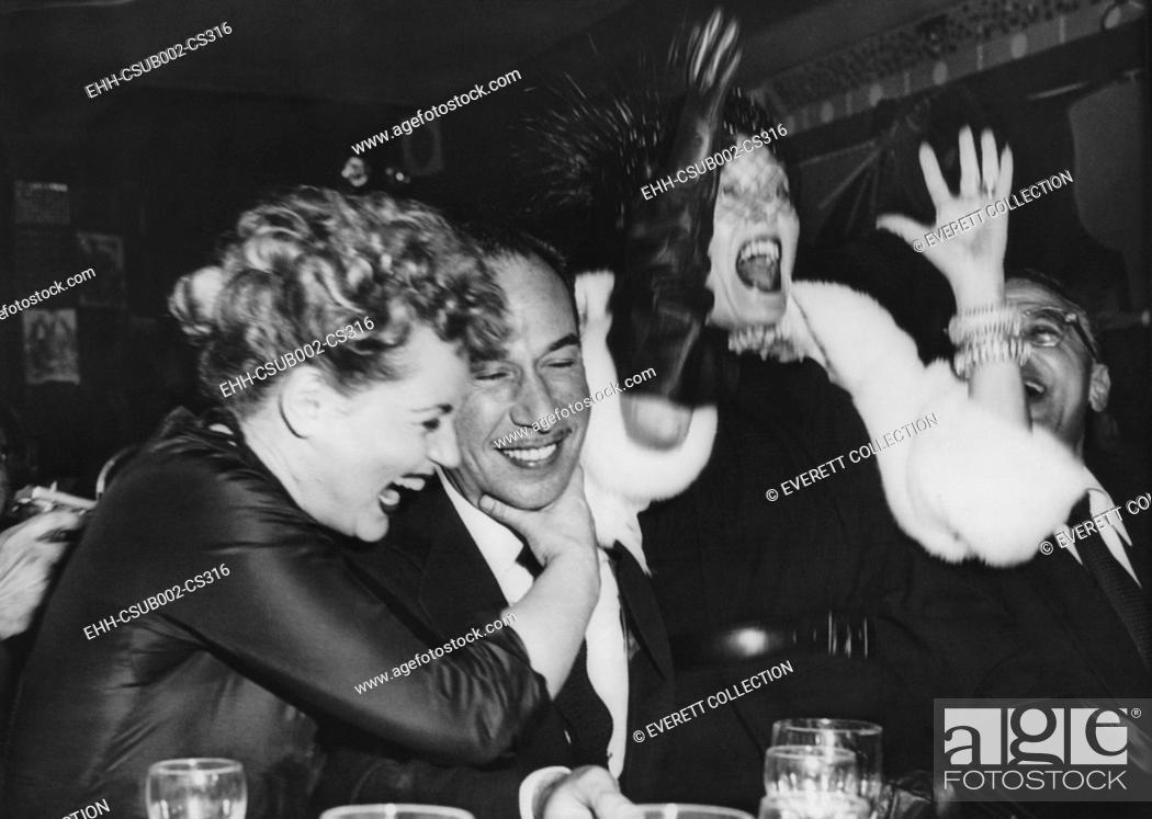 Stock Photo: Judy Holiday (left) hugs Jose Ferrer after they heard that Ferrer and Holiday both won Oscars. March 29, 1951. They were in a New York City nightclub with.