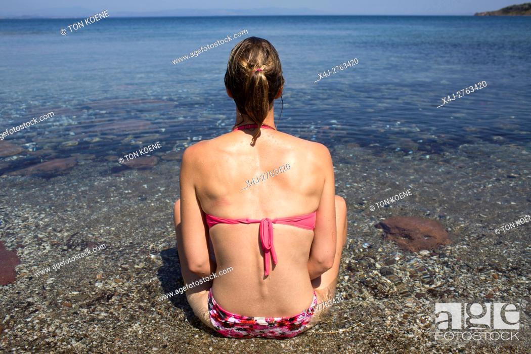 Photo de stock: woman is sunbathing in Levbos, Greece.