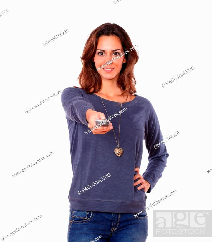 Stock Photo: Portrait of a gorgeous young woman pointing the remote control on white background.