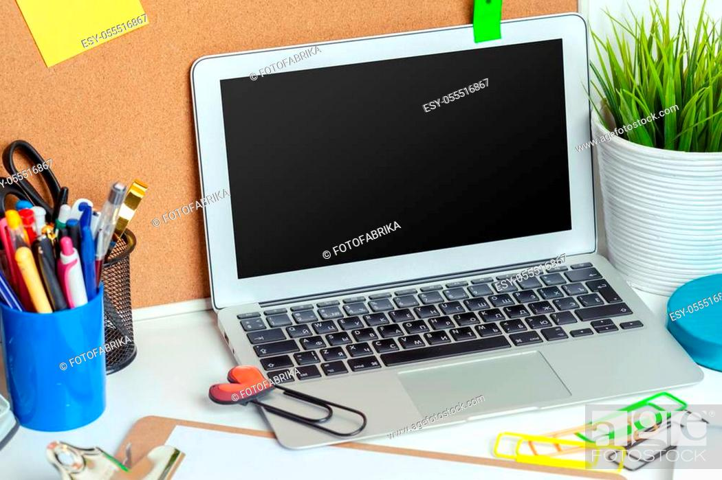Stock Photo: Work place of a creative person with a variety of colorful stationery objects.