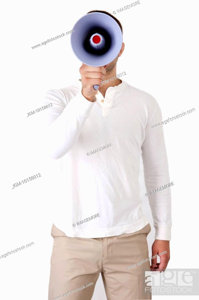 Stock Photo: Young man standing and holding megaphone.