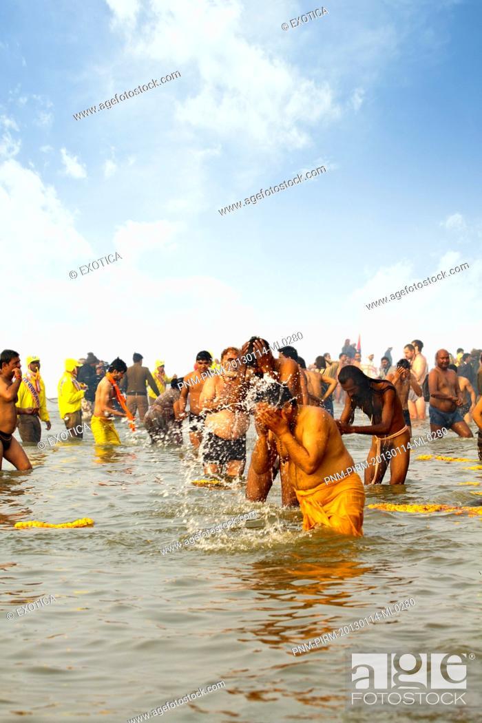 Stock Photo: Pilgrims bathing in the Sangam river during the first royal bath procession in Kumbh Mela festival, Allahabad, Uttar Pradesh, India.