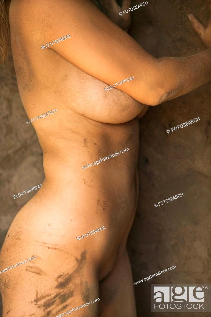 Stock Photo: Close up of young woman's muddy torso.