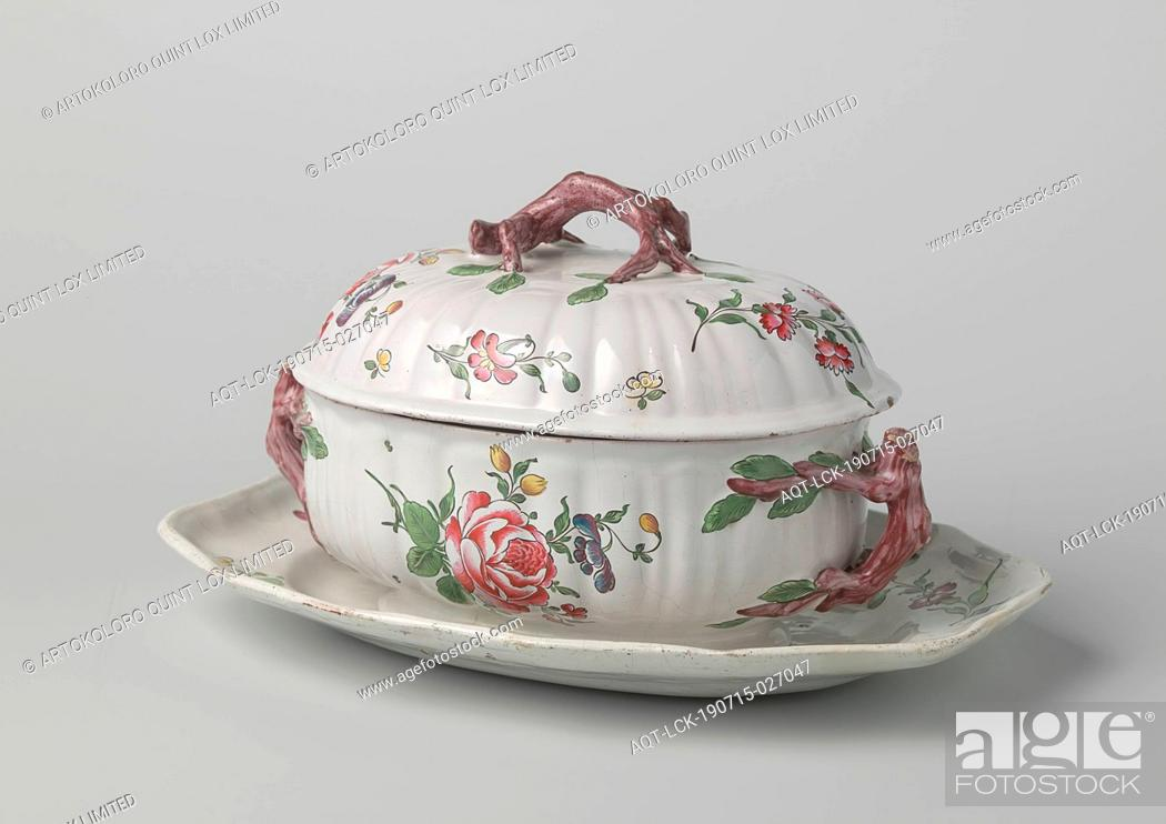 Stock Photo: Dish of terrine with lid, painted with flower sprays, Dish of oval terrine of multi-colored faience. The bottom dish has a lobed edge.