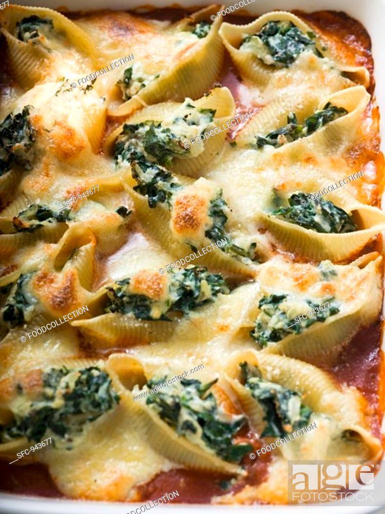 Stock Photo: Gratin of pasta shells with spinach and mozzarella.