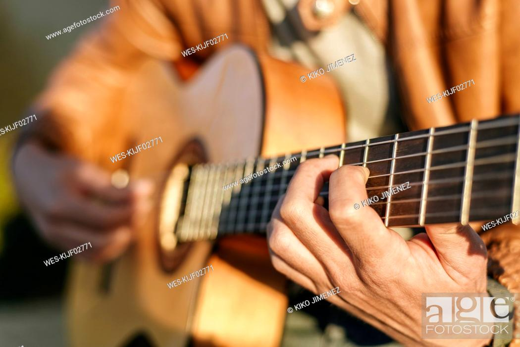 Stock Photo: Close-up of man playing guitar.