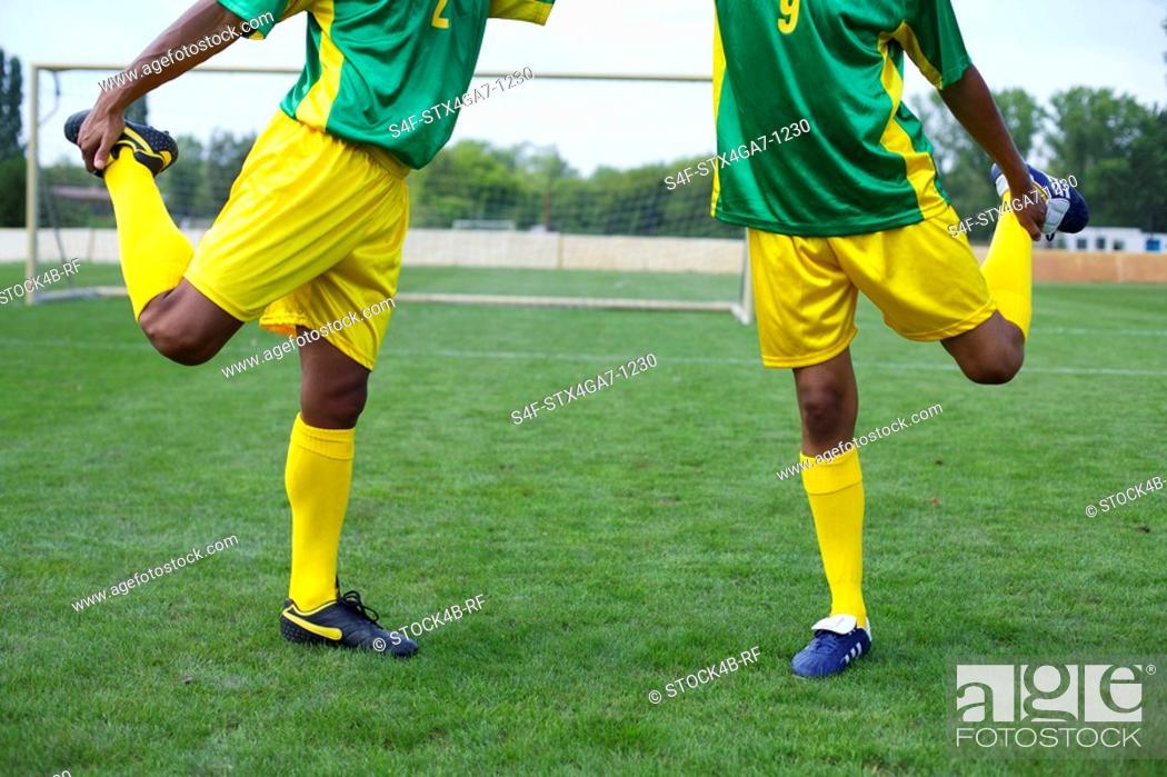 Stock Photo: Brazilian kicker stretching.