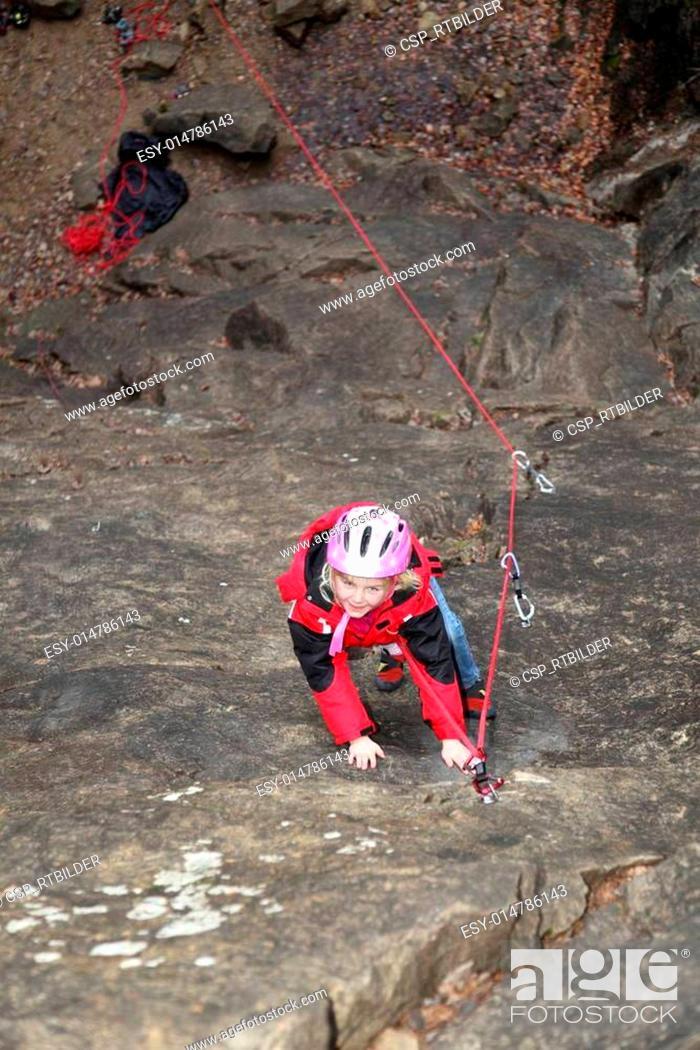 Stock Photo: rock climbing girl.