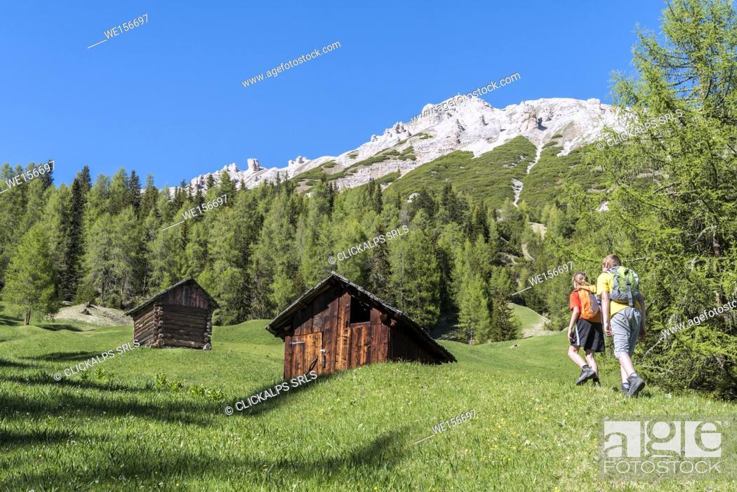 Stock Photo: La Valle / Wengen, Alta Badia, Bolzano province, South Tyrol, Italy. Hikers traveling on the pastures of Pra de Rit.