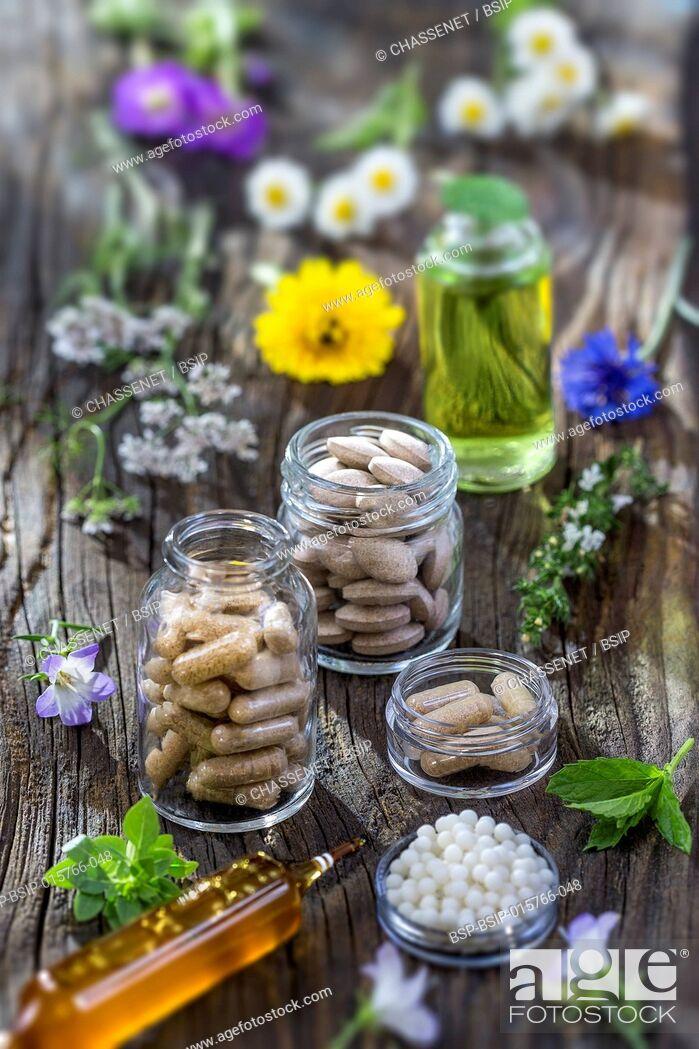 Stock Photo: Alternative herb medicine. herbal vitamin on wooden board.