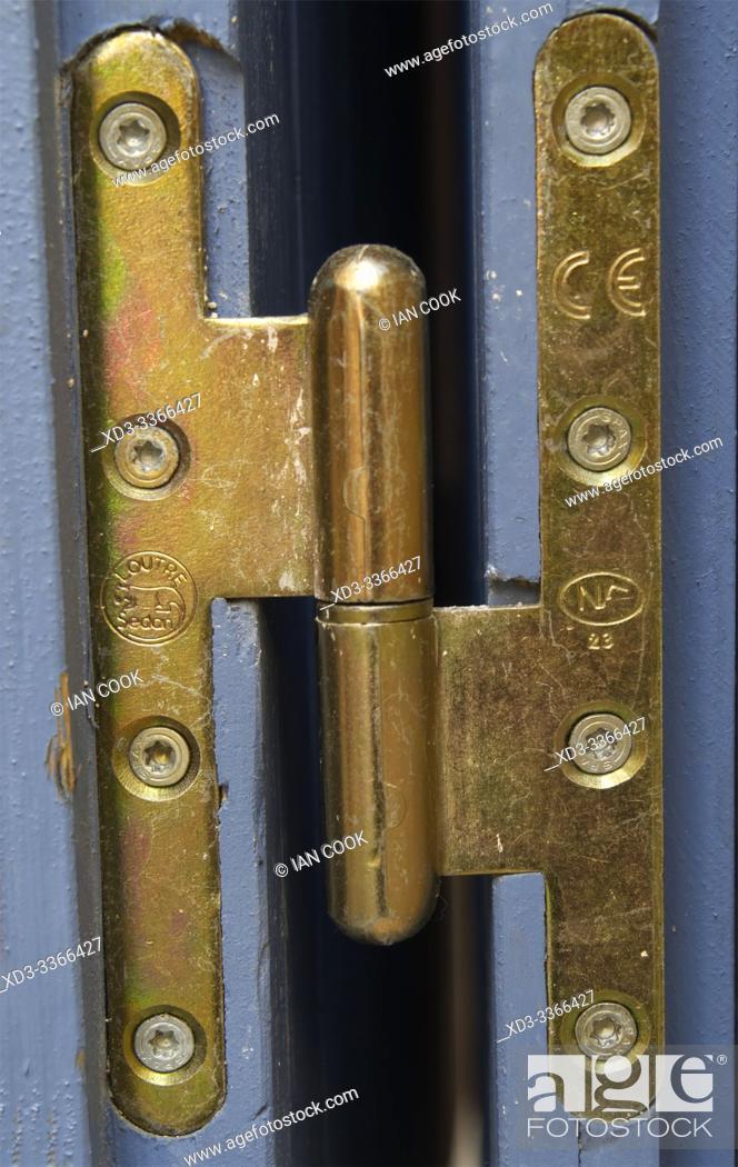 Stock Photo: brass door hinge, Forcalquier, Provence, France.