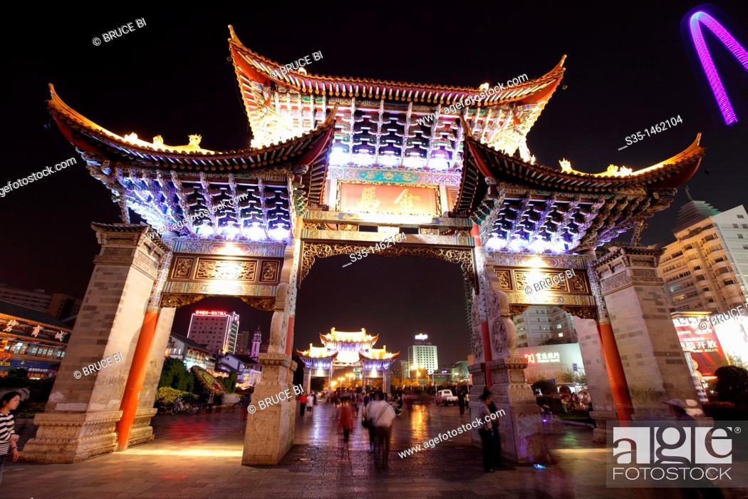 Stock Photo: Night view of memorial arches of the Golden Horse and Jade Rooster in Jinmabiji Square, Kunming, China.