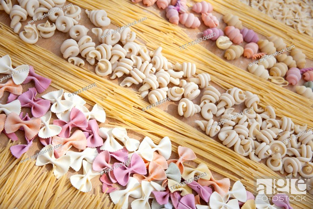 Stock Photo: Assorted uncooked pasta in rows.