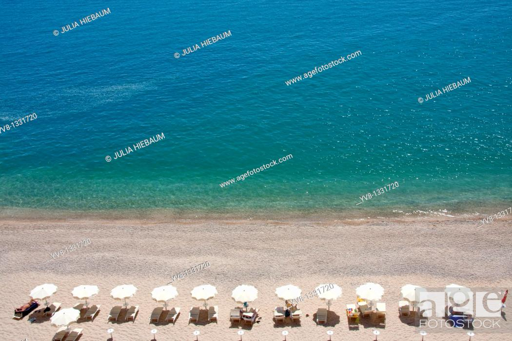 Stock Photo: Tourists relaxing by the seaside in Puglia, Italy.