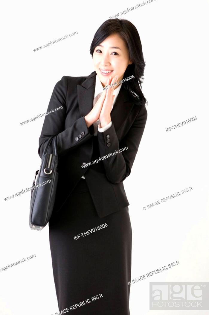 Stock Photo: businesswoman holding a briefcase.