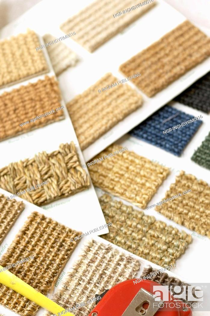 Stock Photo: Close-up of swatches of carpeting displayed on sheets.