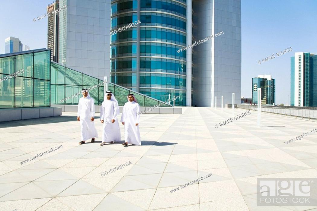 Stock Photo: Middle eastern businessmen on a skyscraper.
