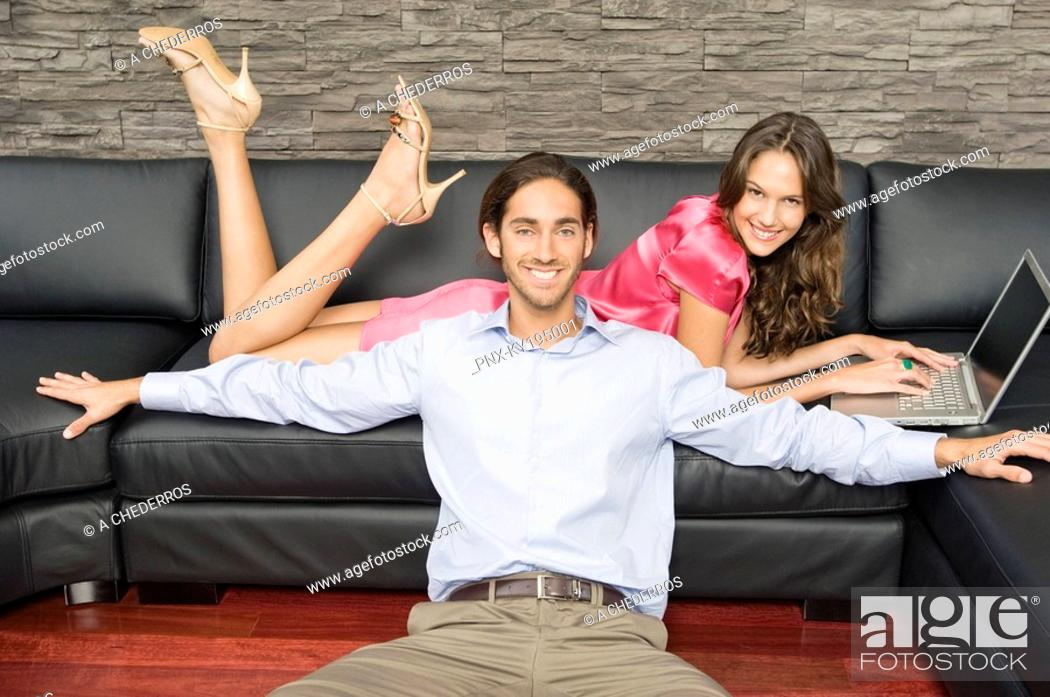 Stock Photo: Couple in a living room.