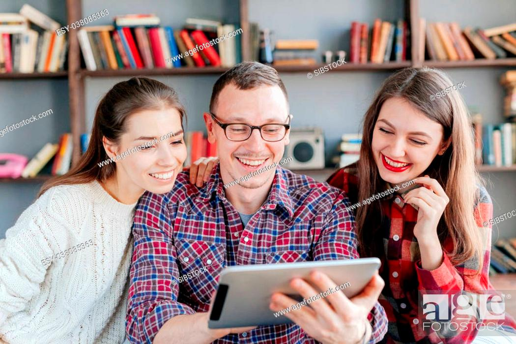 Stock Photo: education and internet - smiling students looking at tablet pc in lecture at school.
