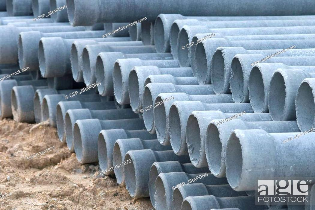 Stock Photo: Stack concrete drainage pipe in construction site.