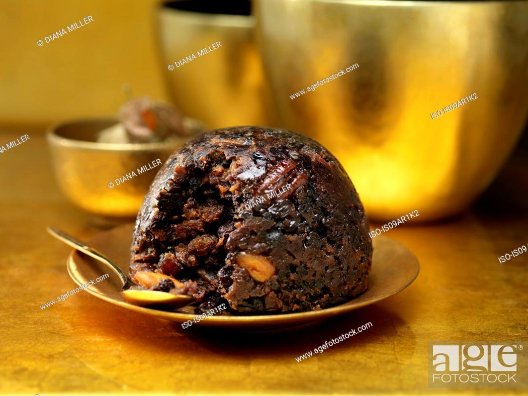 Stock Photo: Christmas pudding on gold ceramic plate.