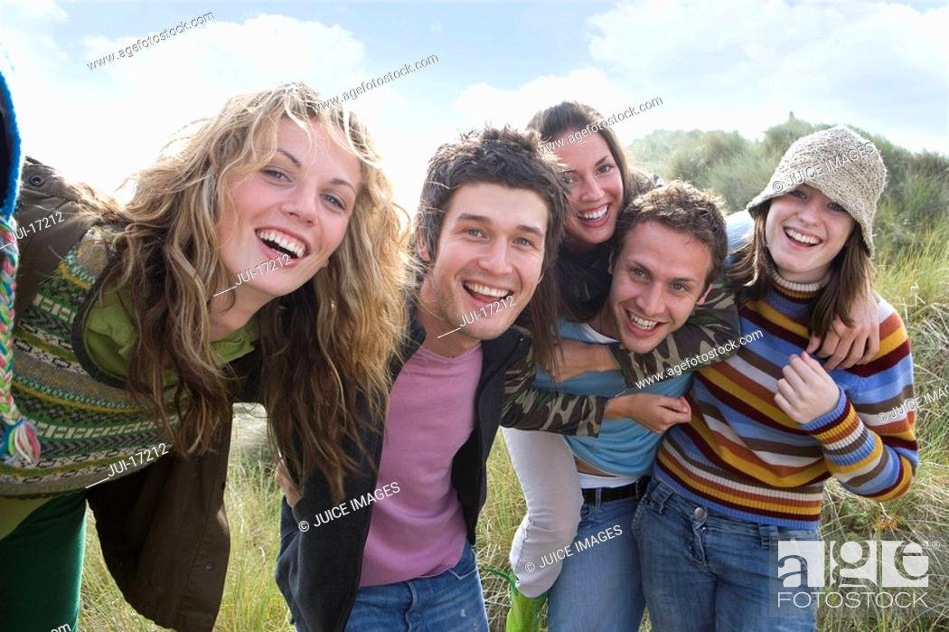 Stock Photo: Portrait of young adults at beach.