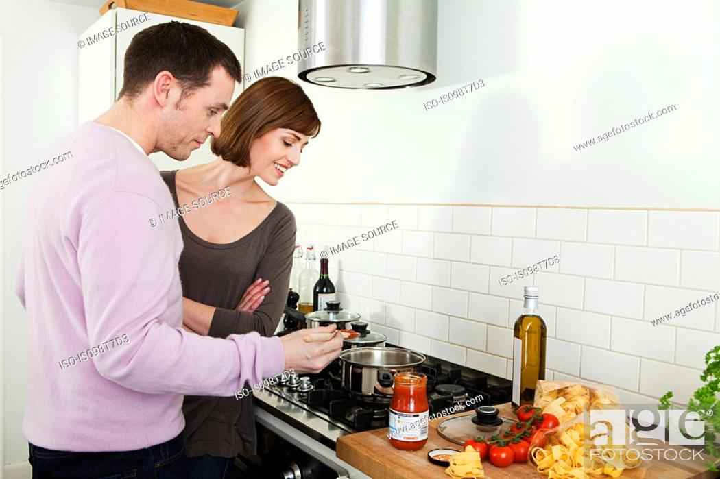 Stock Photo: Couple cooking.