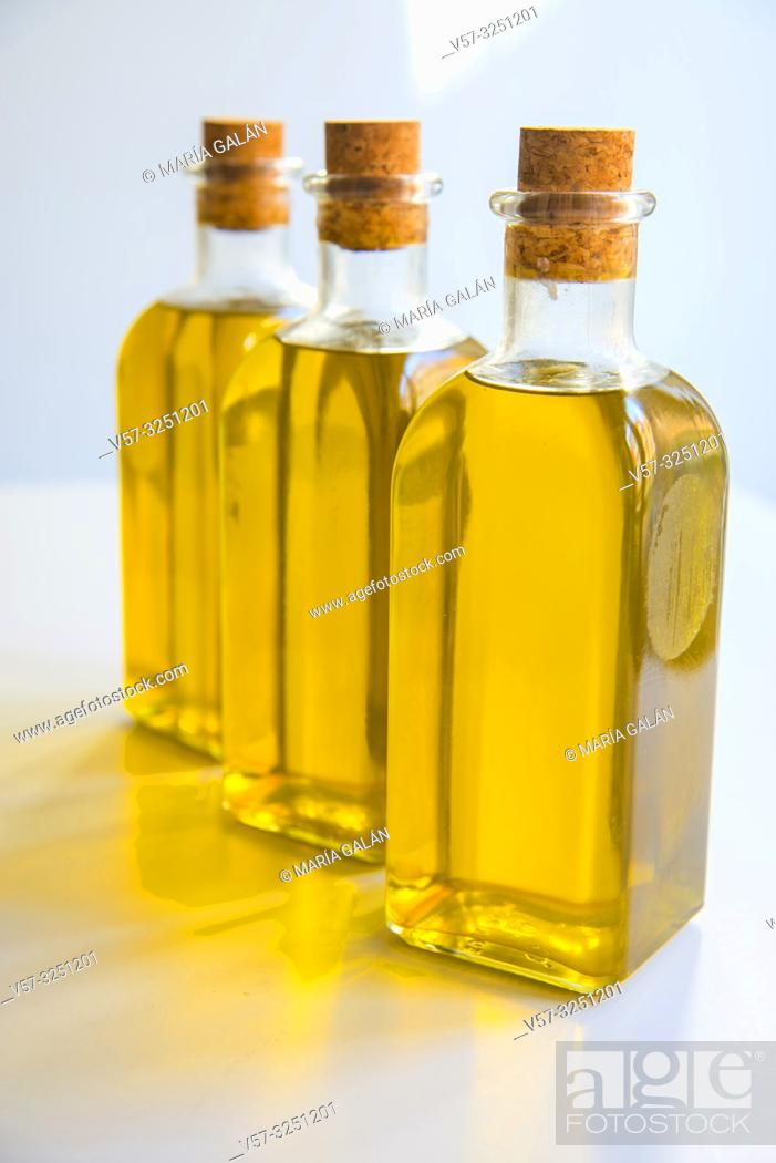Stock Photo: Three oil bottles with olive oil. Spain.