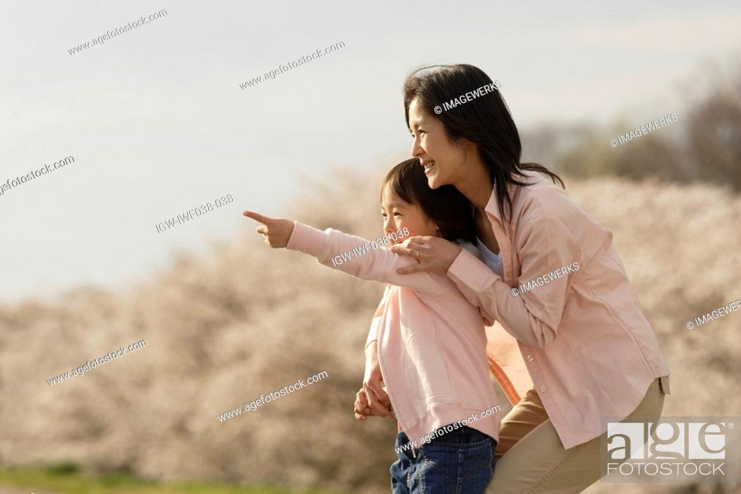 Stock Photo: View of a girl pointing with finger.